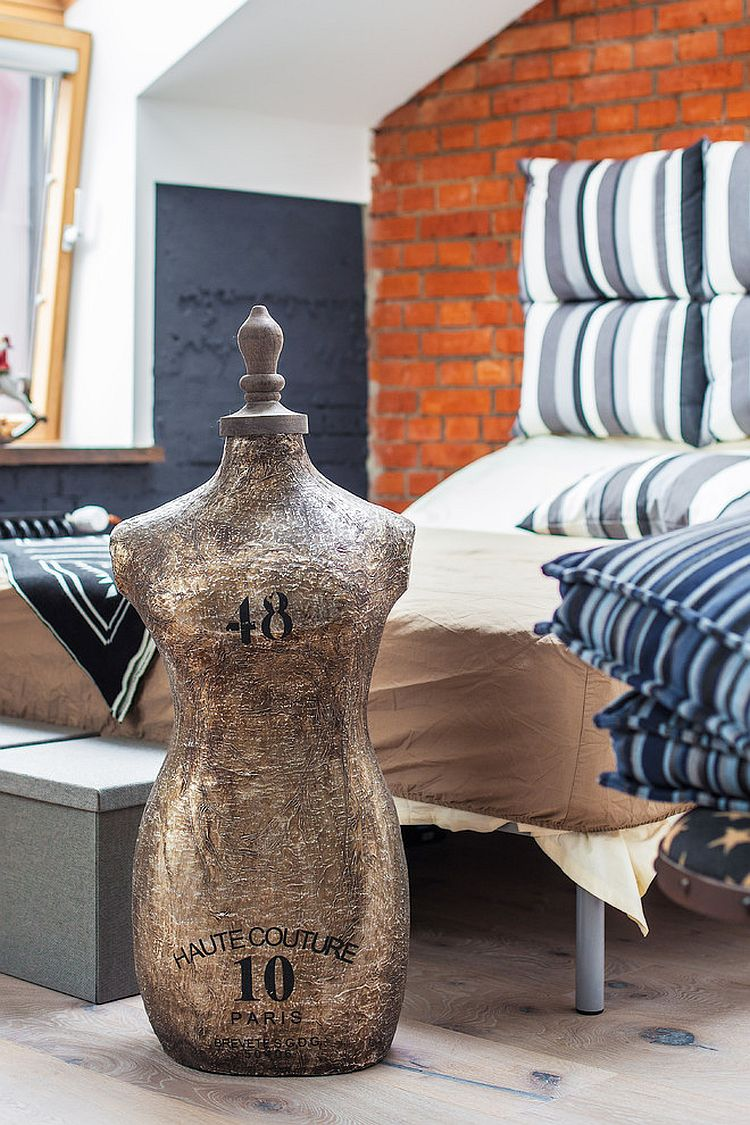 Unique accessories give an eclectic charm to the industrial bedroom