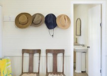Wall-mounted-hooks-over-a-pair-of-entryway-chairs-217x155