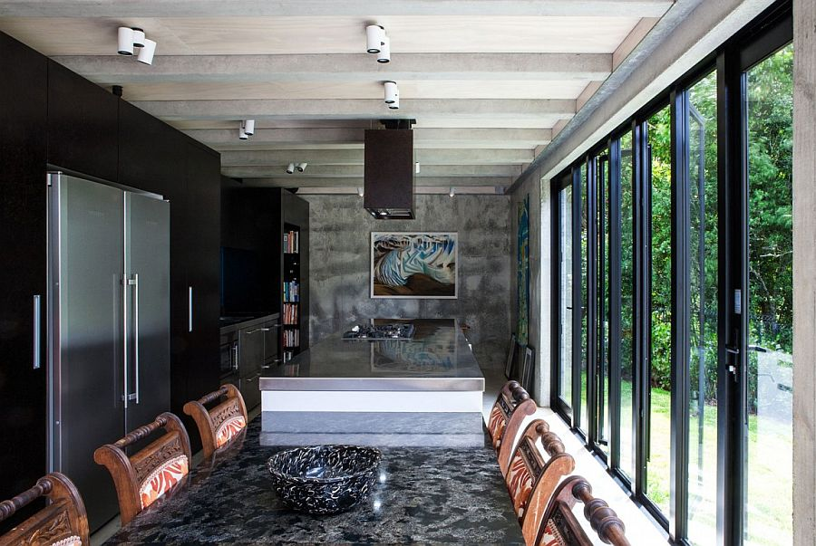 Wall of glass doors connect the kitchen with the outdoors