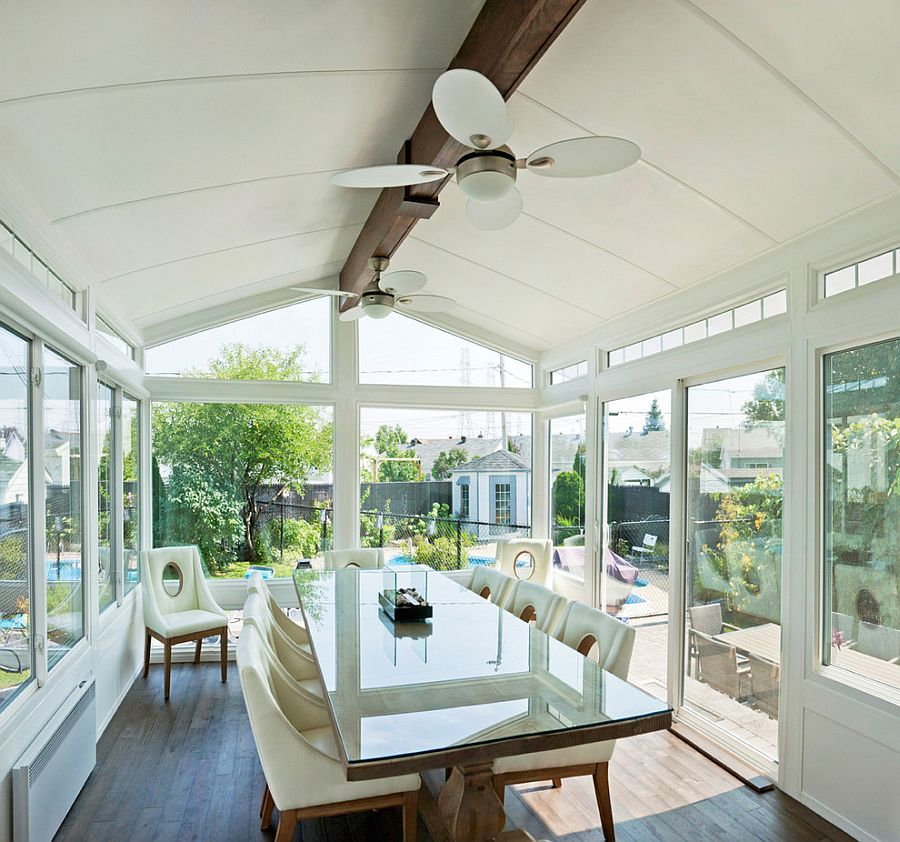 White cathedral style sunroom with a smart dining space [Design: LivingSpace Sunrooms]
