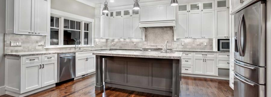 White granite in a white kitchen with metallic tones