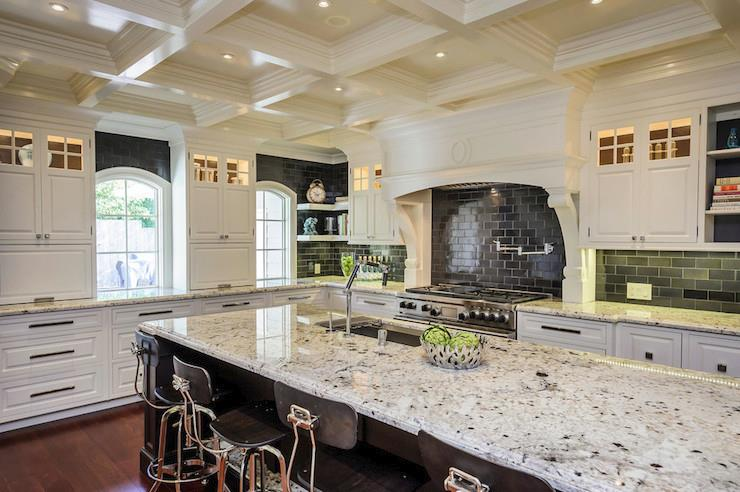 White ice granite in a high-contrast kitchen