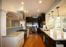 White ice granite in a kitchen filled with wooden tones