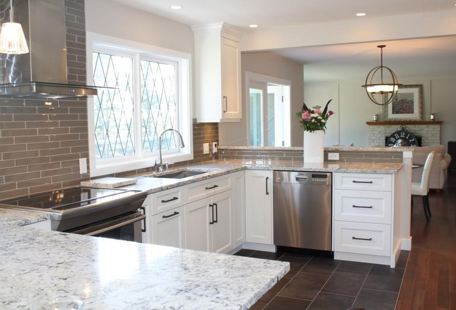 White ice granite in a kitchen with grey tile