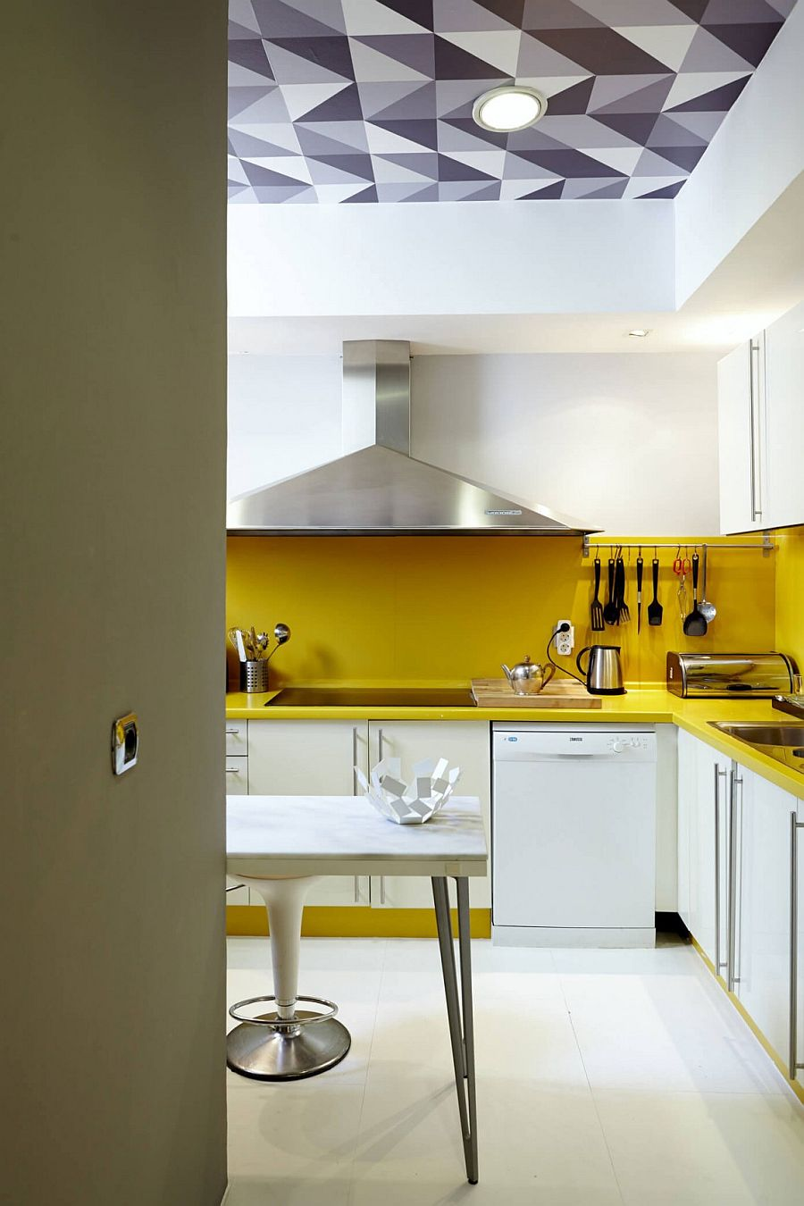 White kitchen with a vivacious yellow backsplash