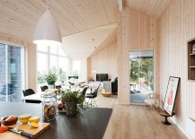 Wooden walls and roof of the summer home gives it inviting warmth