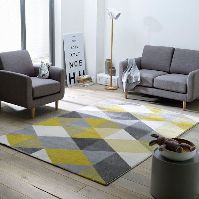 View In Gallery Yellow And Gray Rug Adds A Subtle Pop Of Color