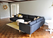 Yellow area rug with ottoman