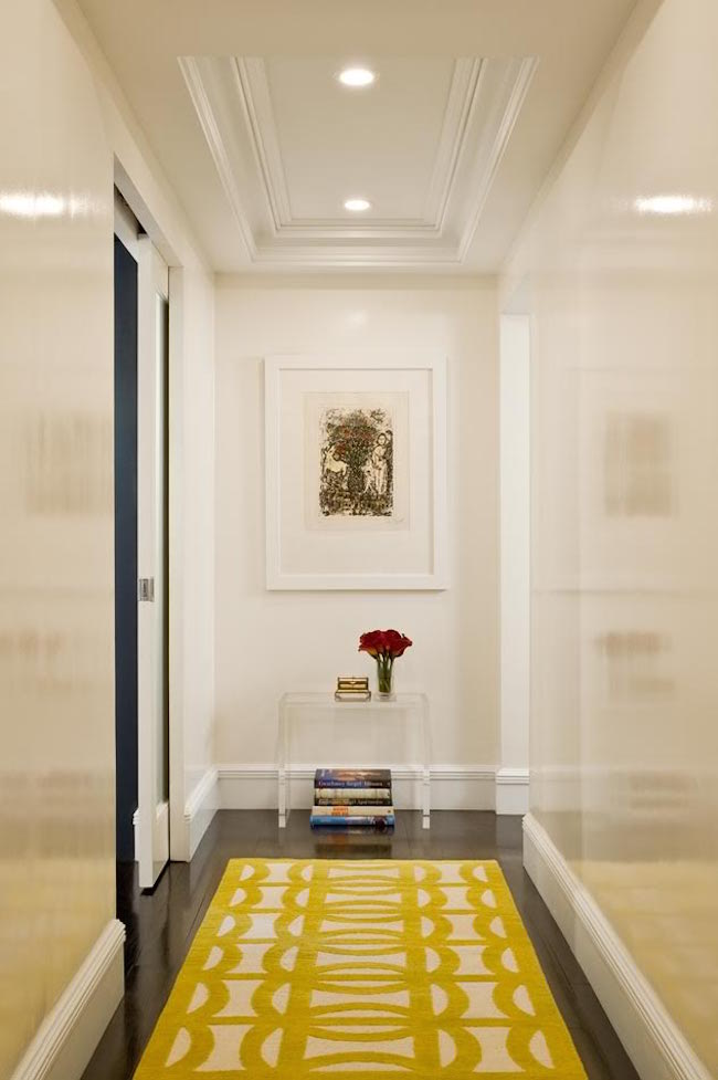 Yellow hallway rug on dark hardwood flooring