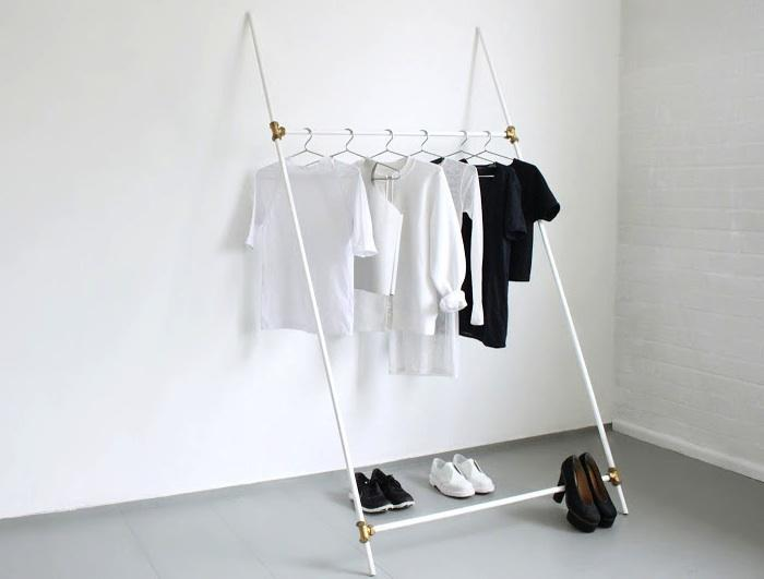 Very minimal and slanted white clothing rack