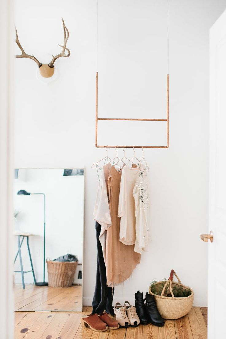Small geometric structure hung from ceiling for clothing storage