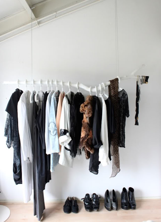 White faux branch used to hang clothing