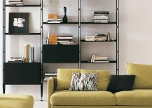 green couch in front of 935 Infinito modular shelving