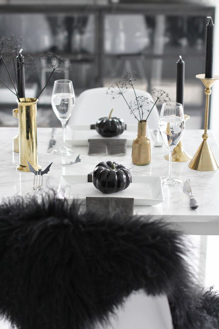 A less scary Halloween table setting in black and gold