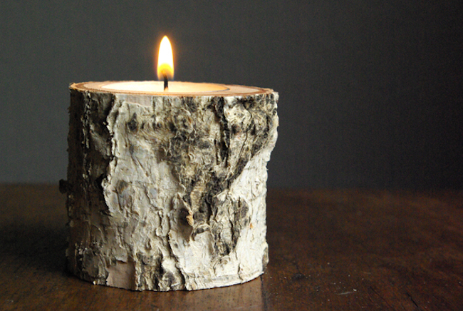 A tea light fits right inside the birch wood