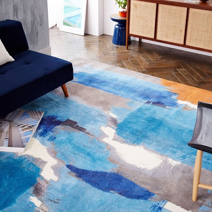 Abstract blue rug with orange accents from West Elm