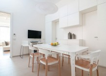 All-white dining space with televsion is a showstopper