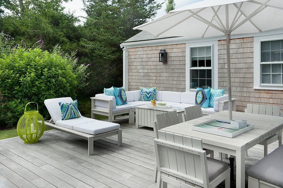 all white outdoor decor for the deck with light blue accent pillows design