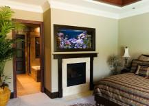 Aquarium-above-fireplace-in-bedroom-217x155