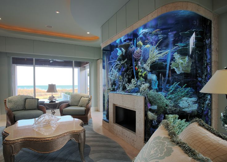 Aquarium surrounding fireplace in living room