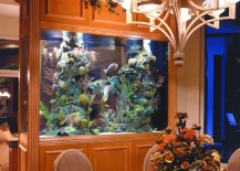 Aquarium used to separate dining room from living room 217x155 8 Extremely Interesting Places to Put an Aquarium in Your Home