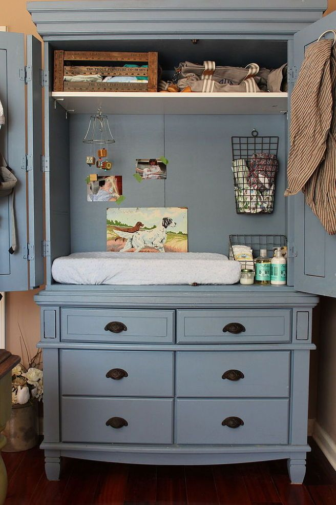 Armoire repurposed as a baby changing table