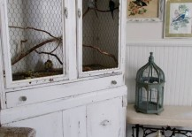 Armoire repurposed as a bird cage for real pet birds