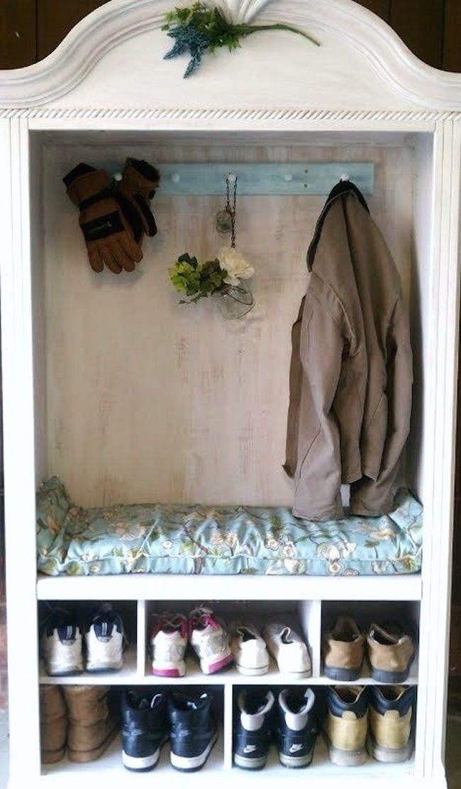 Armoire used for coat and shoe storage in a mudroom