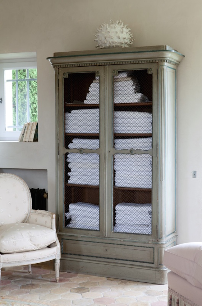 Armoire used to store bathroom towels