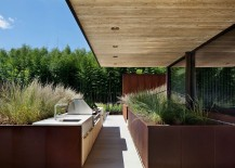 Barbeque area of the East Hampton home surrounded by natural greenery