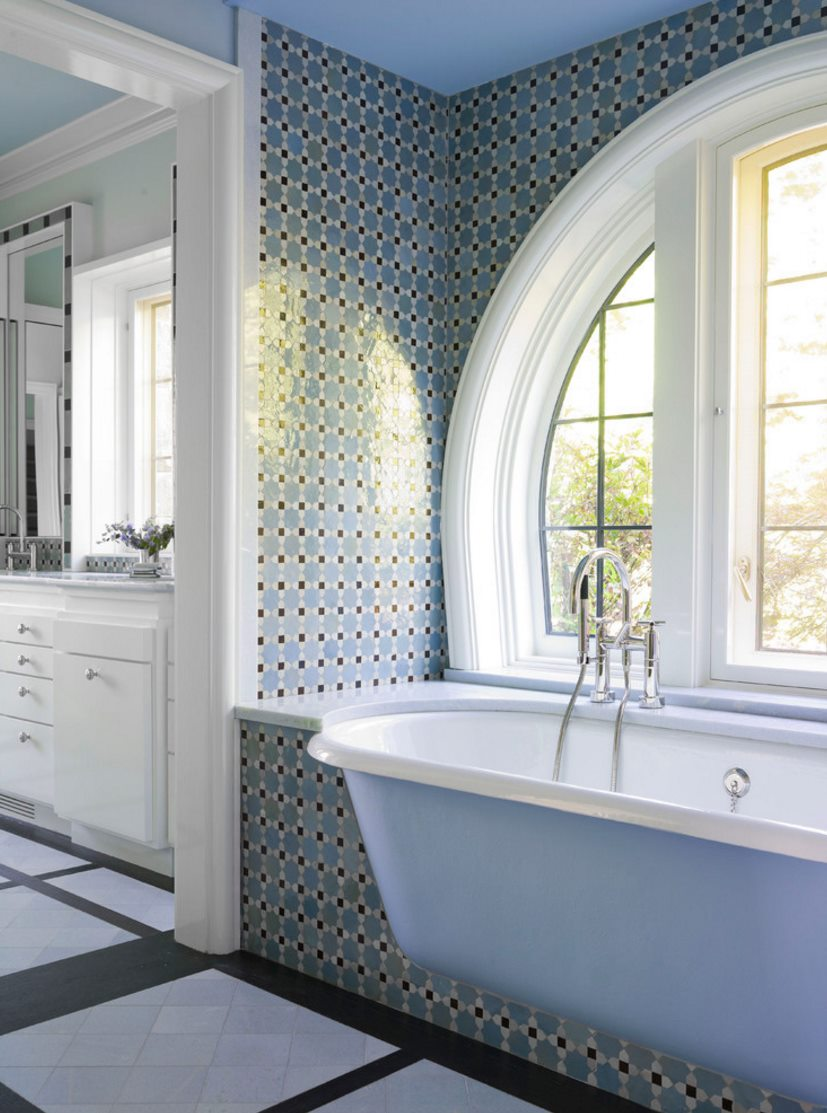 Bathtub with rounded edges in a traditional powder room