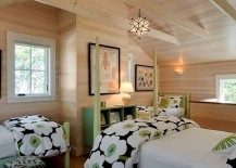 Beach style bedroom with woodsy wall and pops of green