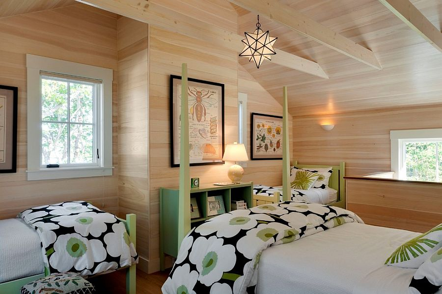 Beach style bedroom with woodsy wall and pops of green [Design: Wright-Ryan Homes]
