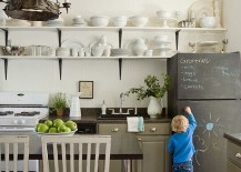 Breadboard wall and chalkboard elegance come together in this eclectic kitchen [Design: Lauren Liess Interiors]