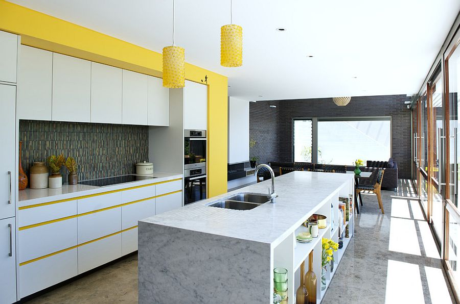 Beautiful midcentury modern kitchen with pops of yellow [Design: Klopper and Davis Architects]