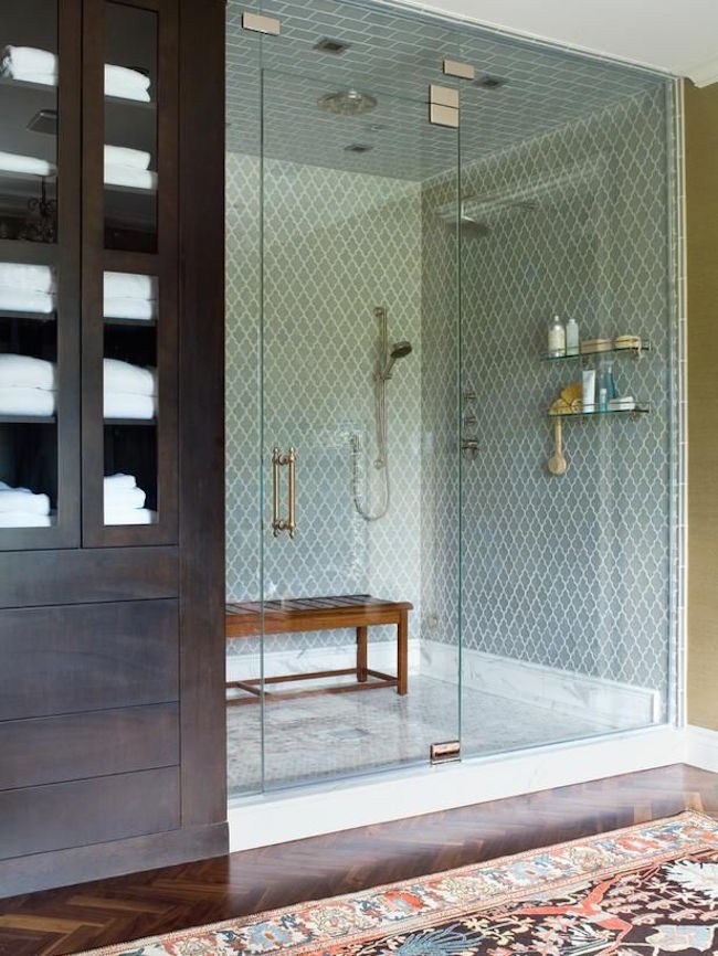 Bench placed in large walk-in shower as alternative to built-in
