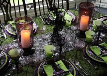 Black and green Halloween dinner setting with spiderwebs