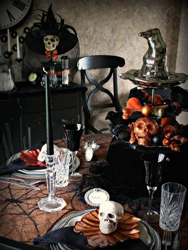Black and orange Halloween table setting with lots of skulls