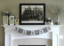 Black and white Halloween fireplace mantel with family photo of witches 217x155 18 Spooktacular Halloween Ideas for Your Fireplace Mantel