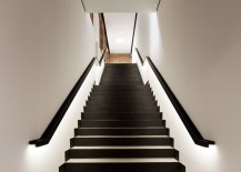 Black and white staircase with lighting along railings 217x155 15 Modern Staircases with Spectacular Lighting
