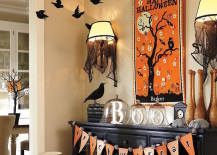 Black fireplace with elaborate Halloween decor that extends above it