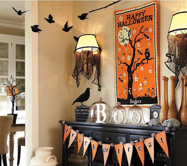 18 'Spooktacular' Halloween Ideas For Your Fireplace Mantel