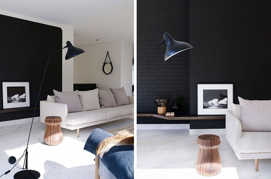 Black walls and floatings shelves coupled with decor in lighter hues