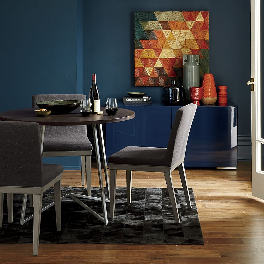 Blue and orange in a CB2 dining room