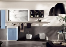 Blue floor stand base and wall hung cabinets create contemporary bathroom