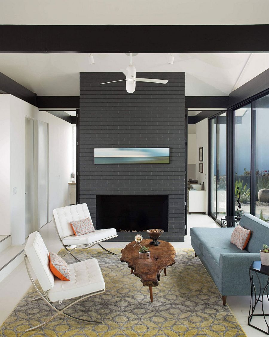 Breezy living room with gray fireplace wall