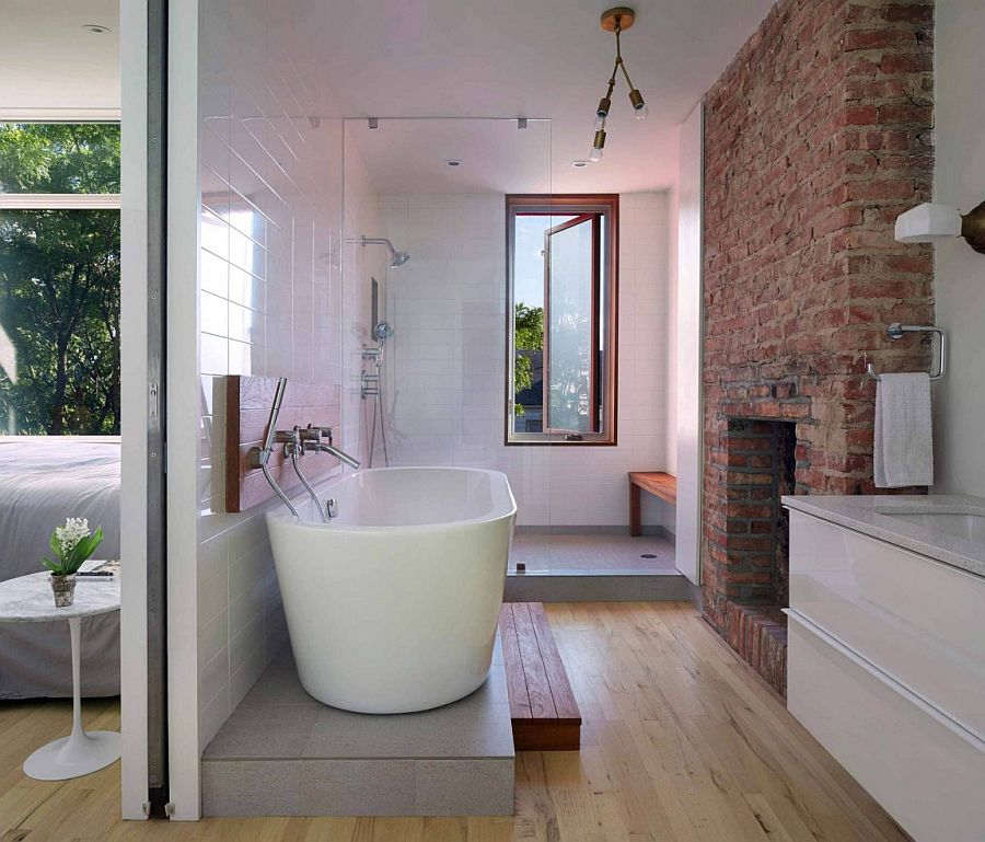 Brick Chimney Breast in the contemporary bathroom with standalone tub