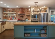 Brick wall adds character and texture to the spacious kitchen with smart island