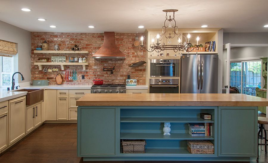 Brick wall adds character and texture to the spacious kitchen with smart island [Design: Tal Goldstein]