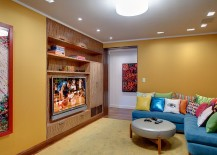 Bright-L-shaped-couch-in-blue-with-colorful-accent-pillows-for-the-TV-room-217x155